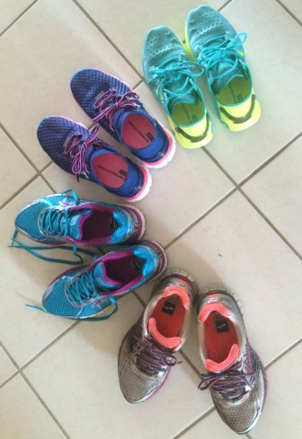 The four pairs of running shoes I am currently using. They each are great for different training runs I do.