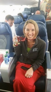 Sporting my medal on the flight home.