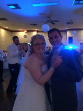 Kristi on her wedding day, dancing with my husband Chris.