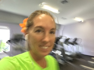 Treadmill selfie wearing my orange flower!