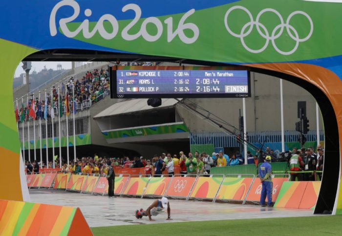 U.S. Mebrahtom Keflezighi exercises after completing the marathon men's marathon at the 2016 Summer Olympics in Rio de Janeiro, Brazil, Sunday, Aug. 21, 2016. (AP Photo/Luca Bruno)