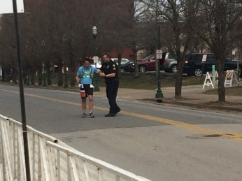 Officer John congratulates a runner