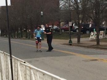 Officer John congratulates a runner
