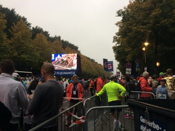 Large TVs in the corrals allowed runners the chance to watch the start of the marathon